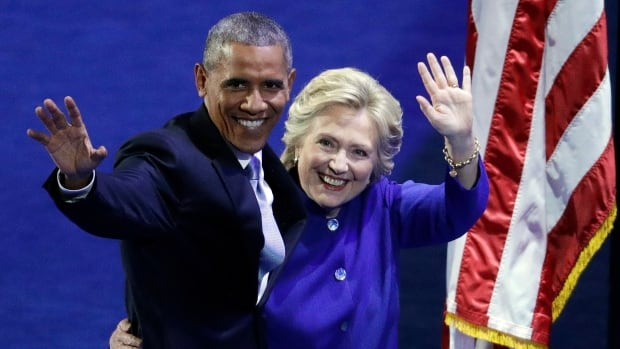 President Barack Obama and Democratic presidential candidate Hillary Clinton wave to the crowd during the third day of the Democratic National Convention.