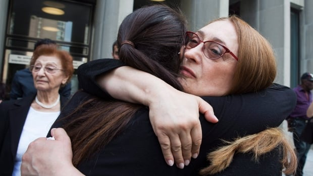 Sammy Yatim's mother Sahar Bahadi embraces her daughter Sarah at a Toronto courthouse after the sentencing of Const. James Forcillo in Toronto on Thursday, July 28, 2016.