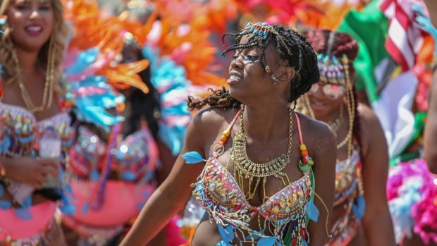 Despite infighting, and money woes, Toronto's Caribbean Carnival celebrates 50 years of dancing, music and masquerade outfits.