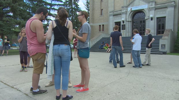 People gather outside the Holy Rosary Cathedral in Regina to play Pokemon Go.