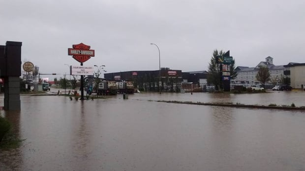 Torrential downpours flooded areas of Fort McMurray, Alta., on the weekend, prompting the Regional Municipality of Wood Buffalo to reopen its emergency operations centre.