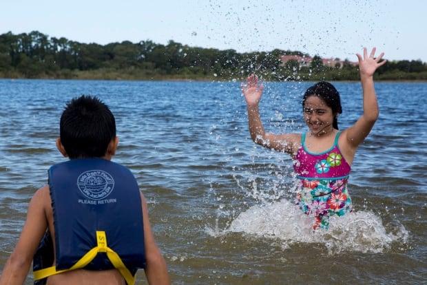 Lake fun generic children playing sunshine cottage