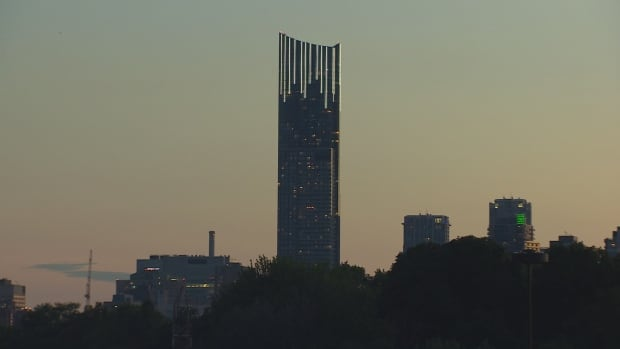 Aura condo building Toronto skyline