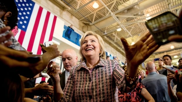Democratic presidential candidate Hillary Clinton, surging in the polls, greets members of the audience after speaking at a rally in Omaha, Neb., on Monday.