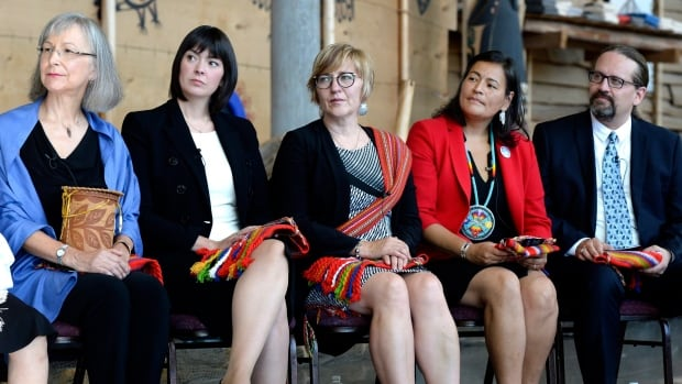From left, commissioners Marion Buller, Qajaq Robinson, Marilyn Poitras, Michele Audette and Brian Eyolfson listen during the launch of the inquiry into murdered and missing Indigenous women and girls at the Museum of History in Gatineau, Que.
