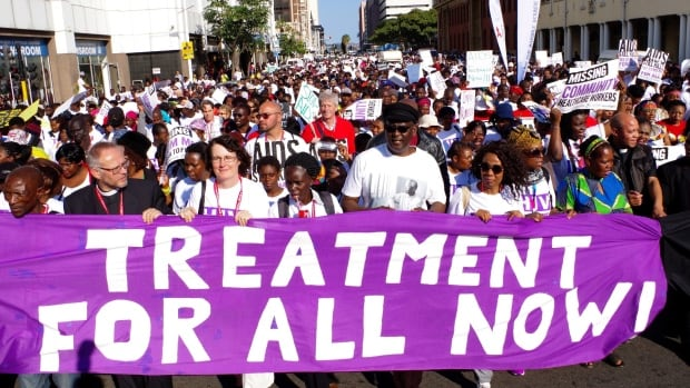 Civil rights activists march in Durban, South Africa, on July 18 at the start of the 21st World Aids Conference. UN secretary general Ban Ki-moon told reporters the gains the world has made against HIV/AIDS are 'inadequate and fragile.' Some activists say the same is true here in Canada.
