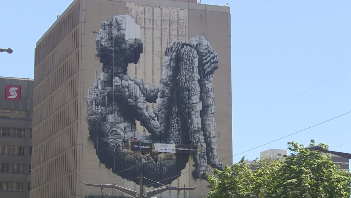 Street artist phlegm spruces up midtown office building for Mural on building