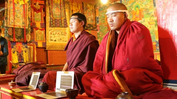 Monks at the Tengboche Monastery in Tibet meditate while their brain activity is recorded with the EEG system.
