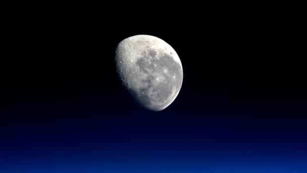 The setting moon is seen in a photograph taken by Expedition 47 Flight Engineer Tim Peake of the European Space Agency from the International Space Station on March 28, 2016.