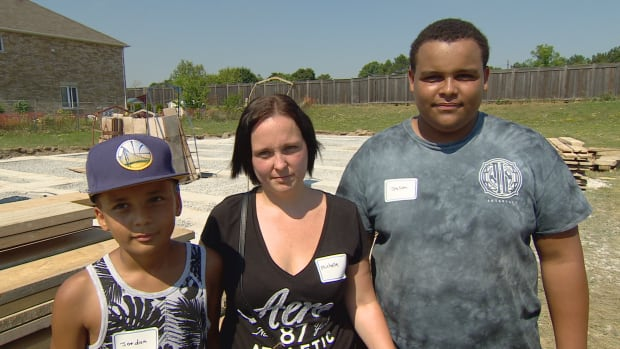 Jordan, Michelle and Jason Mouldey will soon go from renters to owners, one of 50 families set to move in to Habitat for Humanity's new complex on Pinery Trail in the next two to three years.