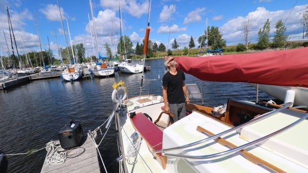 Ottawa sailor Chris Fournier performs a few final inspections before he sets out on an attempted round-the-world journey.