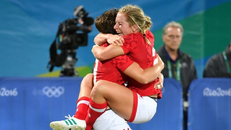 Canada s Ghislaine Landry and Kayla Moleschi celebrate in the womens rugby  sevens quarter-final match between Canada and France during the Rio 2016  Olympic ... 3344f90ab3
