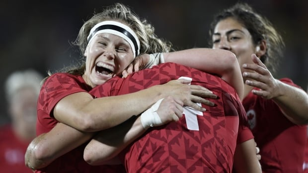 Canada rejoices after scoring against Great Britain