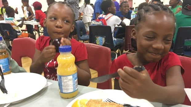 These are two of an estimated 250 children who attended a barbecue lunch put on by Sodexo and Second Harvest at the Driftwood Community Recreation Centre Wednesday. It's part of the Feeding Our Future program for underprivileged kids.