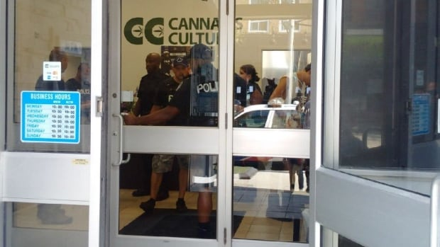 Officers raided Cannabis Culture's Queen Street East location on Wednesday. Its Queen Street West marijuana dispensary was raided by police in June.