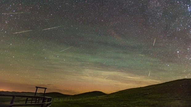 Research from York University has found that visible airglow, shown here with Perseid meteors in Grasslands National Park in Saskatchewan, occurs as result of atmospheric conditions.