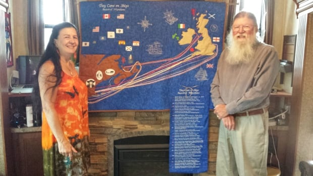 David Walker and Suzan Bouchard pose with the quilt.