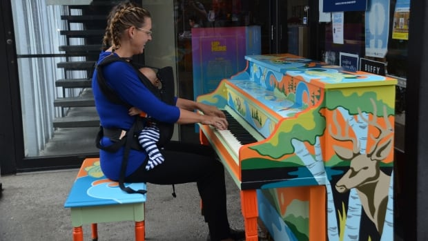 Singer-songwriter Sarah Craig Matt plays a tune on a colourful community piano in downtown Sudbury, Ont., last summer.
