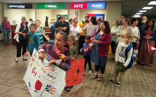 Welcoming Syrian refugee family at Gander airport