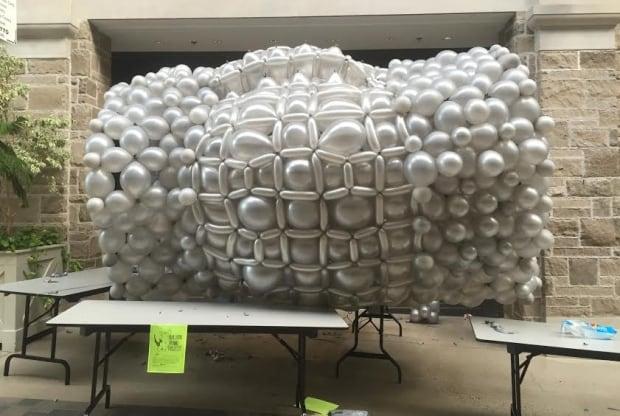 Sean Rooney balloon rhino torso