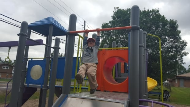 Long Lake resident Adwin Morin enjoys playing on the equipment at Kivi Park.