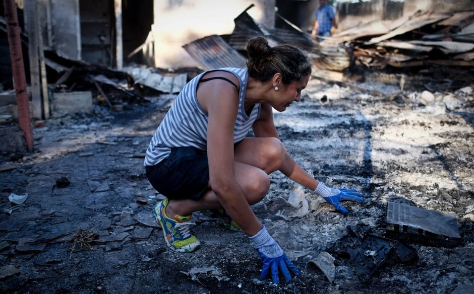 Portugal wildfires woman cries ashes burned house