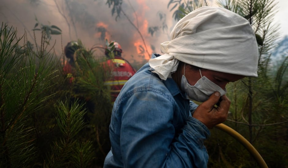 Portugal villager helps firefighters combat raging wildfire
