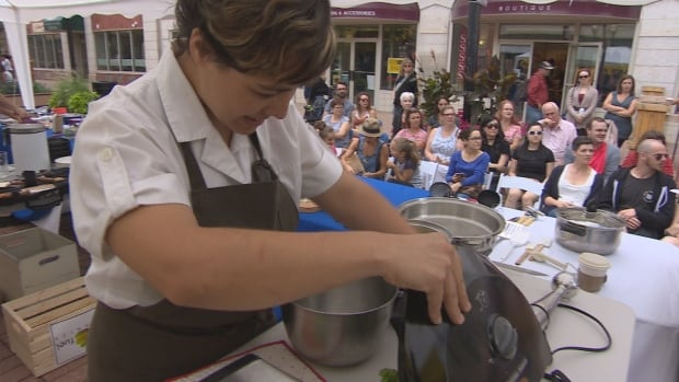 Chef Mariana Brito prepares her meal at the Ethical Eats Mystery Box Challenge in Regina.