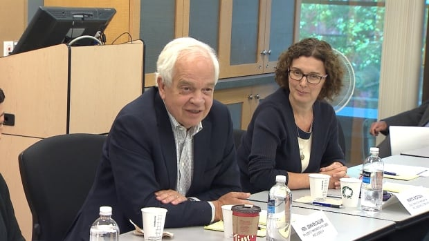 Immigration Minister John McCallum attends a roundtable discussion on immigration in Vancouver. Afterwards, he told reporters the Liberal government wants to boost visas for Chinese nationals, but also encourage new arrivals to settle outside the housing hot spots of Vancouver and Toronto.