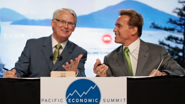 B.C. Premier Gordon Campbell and California Governor Arnold Schwarzenegger joke as they sign an agreement to fight global warming in 2007.