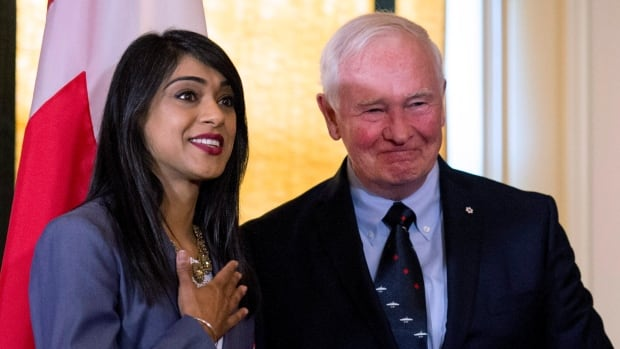 Minister of Small Business and Tourism Bardish Chagger stands next to Governor General David Johnston after being sworn in as Leader of the Government in the House of Commons at Rideau Hall on Friday, Aug. 19, 2016 in Ottawa.