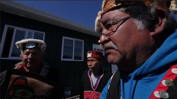 Dzawada'enuxw First Natino Hereditary Chief Willie Moon read out an eviction notice to workers at a Cermaq/Mitsubishi fish farm.