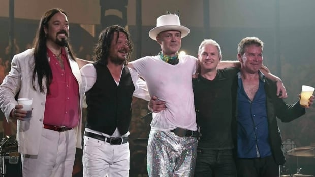 Members of the Tragically Hip gather onstage to acknowledge their fans after ending their Man Machine Poem tour in Kingston, Ont., on Saturday night. From left: Rob Baker, Paul Langlois, Gord Downie, Johnny Fay and Gord Sinclair.