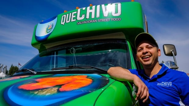 Emmanuel Guardado, who owns the QueChivo Salvadoran food truck, with his vehicle at a park in Calgary on Friday. Guardado had always dreamed of starting his own food business, but it was only when he lost his job in the oil and gas industry that he decided to dive in.