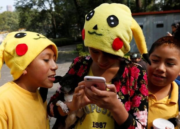 MEXICO POKEMON kids wearing pikachu hats play pokemon go