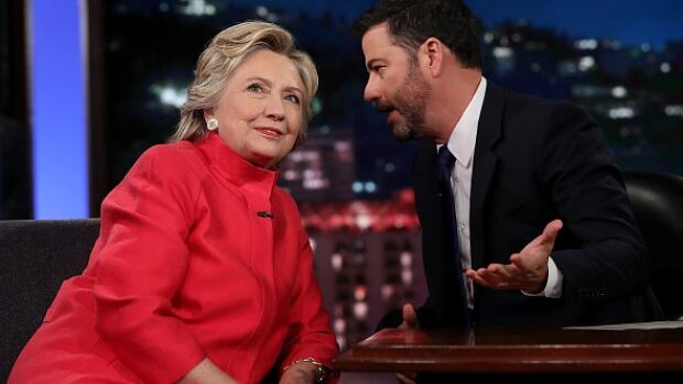 Democratic presidential nominee Hillary Clinton talks with Jimmy Kimmel during a break in the taping of Jimmy Kimmel Live! in Los Angeles.
