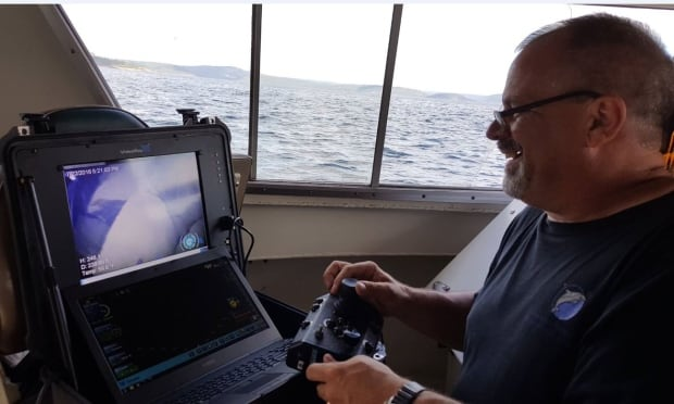 Tom Crossmon driving ROV on Superior