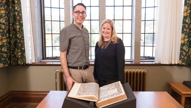 UBC's Gregory Mackie and Katherine Kalsbeek show off their library's latest acquisition: a rare, hand-printed collection of the works of Chaucer.