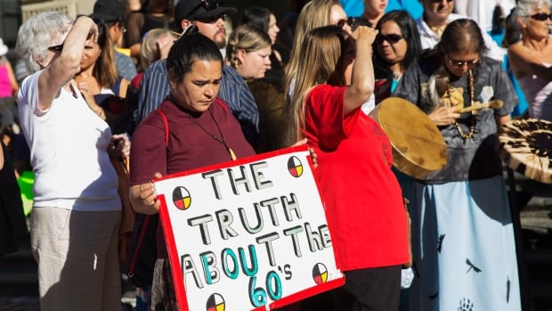 Sixties Scoop survivors and supporters at a demonstration at a Toronto courthouse on Tuesday, August 23, 2016.