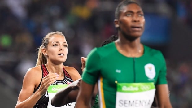 Canada's Melissa Bishop, left, reacts to finishing fourth in the women's 800-metre final  behind South Africa winner Caster Semenya on Aug. 20 at the Rio Olympic Games.