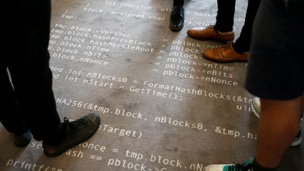 Bitcoin source code printed on a carpet in Berlin. Computer code is at the heart of all digital currencies, including ether, a recent cryptocurrency upstart co-founded by Russian-Canadian Vitalik Buterin.
