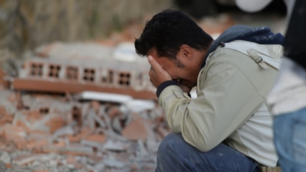 A man reacts after a strong heathquake hit Amatrice on Aug. 24. Central Italy was struck by a powerful, 6.2-magnitude earthquake yesterday morning, which devastated dozens of mountain villages.