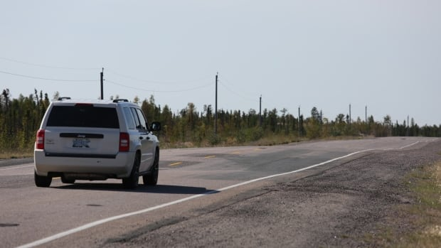 A driver heads over a bumpy stretch of Highway 3, between Yellowknife and Behchoko. The territorial government has been testing methods of reducing bumps and dips in the road - caused by melting permafrost - since 2012