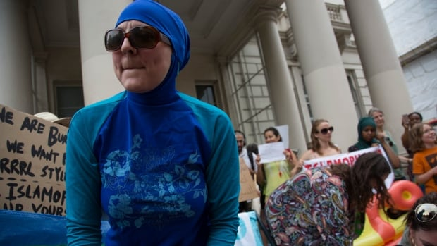 Women protest against the burkini ban on French beaches at the French embassy in London Thursday. A French court overturned local bans Friday.