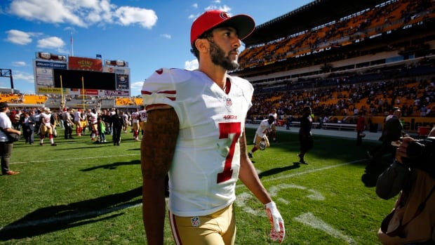San Francisco 49ers quarterback Colin Kaepernick has refused to stand during the U.S. national anthem all pre-season as a protest against racism in the country.