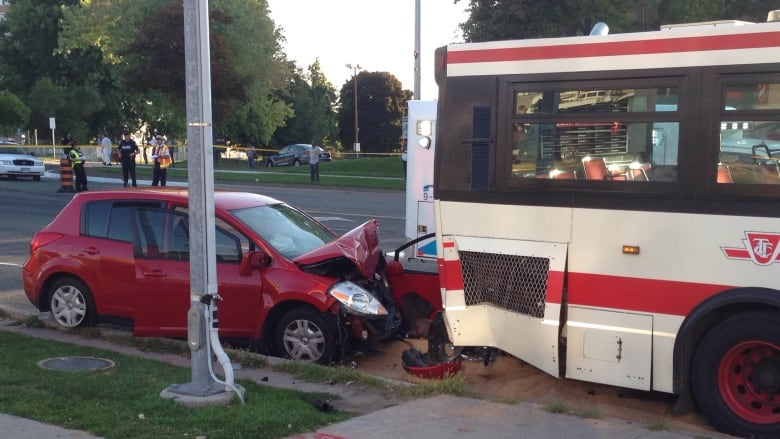Man, 26, dead after car driven by mother rear-ends TTC bus in