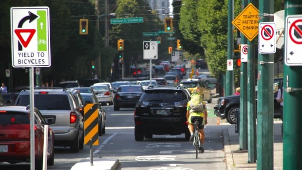 Who will make it to downtown Vancouver first? A cyclist, a transit user or a driver?