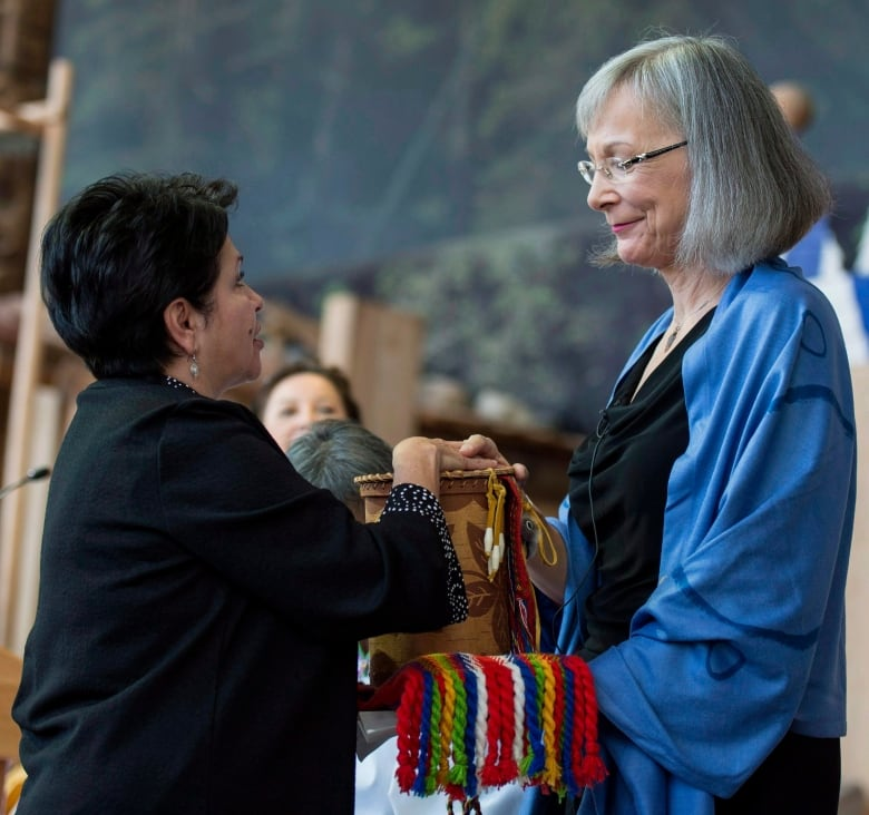 027997c2d67 Elder Claudette Commanda passes a birch bark basket containing stories of  victims and families and cultural items to Judge Marion Buller