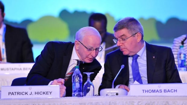 Senior IOC executive member Patrick Hickey, left, was arrested in connection with a ticket-scalping scandal in Rio. It's these kinds of issues that are eroding the public confidence in the organization, writes Olympian Deidra Dionne.