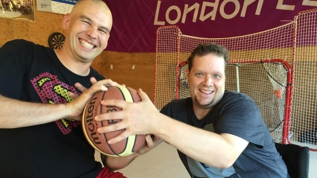 Steve Sampson (left), who has full use of his legs, enjoys playing the parasport of wheelchair basketball with disabled players like Andrew Seely (right).